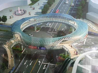 近日又为中国钢结构产业架起了一座时尚壮观的滕州环形天桥.